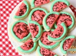 Watermelon Sugar Cookies made easy with sugar cookies, my favorite buttercream frosting and chocolate sprinkles. Perfect for summertime picnics when you can't get enough of watermelon in any form!