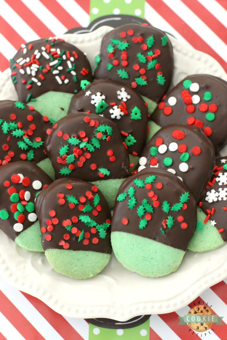 Mint Christmas Cookies made from a buttery shortbread cookie dipped in chocolate & topped with holiday sprinkles.Mint flavored Christmas Cookies perfect for cookie exchanges and gift plates!