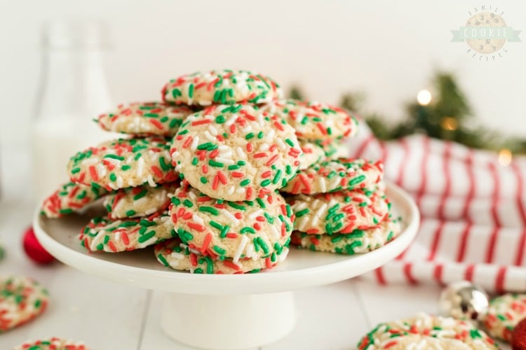 Christmas Sprinkle Cookies are sugar Cookies rolled in Christmas sprinkles for a special holiday treat!Delightfully soft & chewy Christmas cookies made with festive holiday sprinkles!