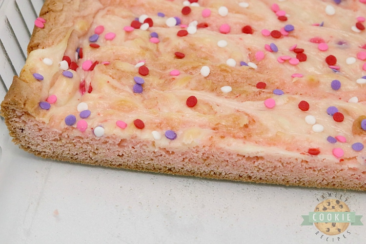 Strawberry cookie bars with swirled cream cheese filling