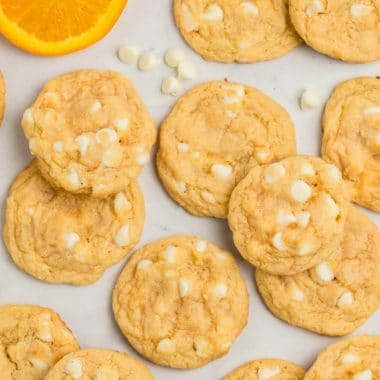Orange Creamsicle Cookies are creamsicles in cookie form! Soft & chewy cookies with bright orange flavor and sweet white chocolate chips.