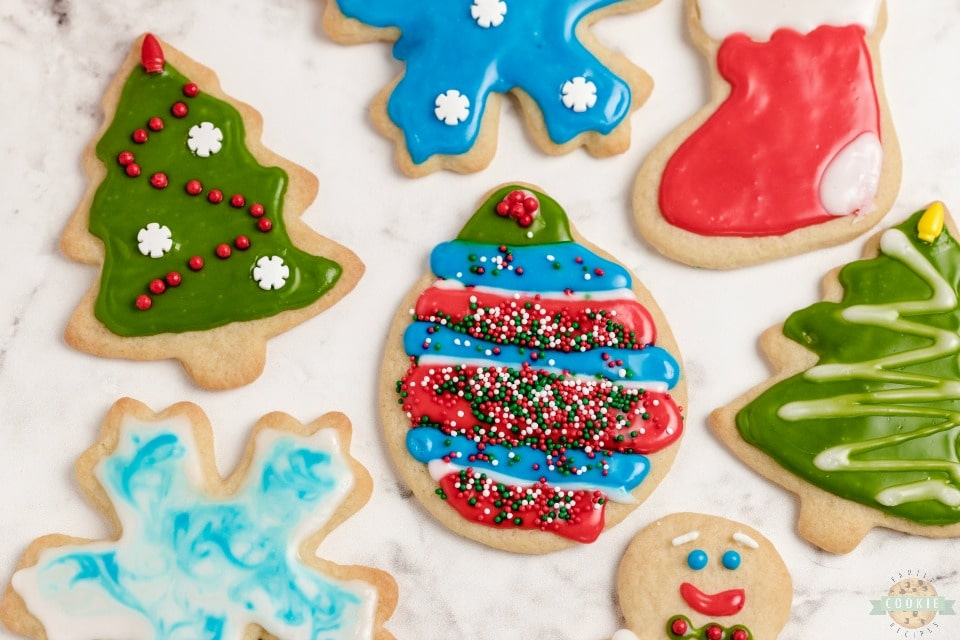 Classic Christmas Cut-Out Cookies perfect for the holidays! Easy sugar cookies for cookie cutters with a simple shiny cookie icing that everyone loves.