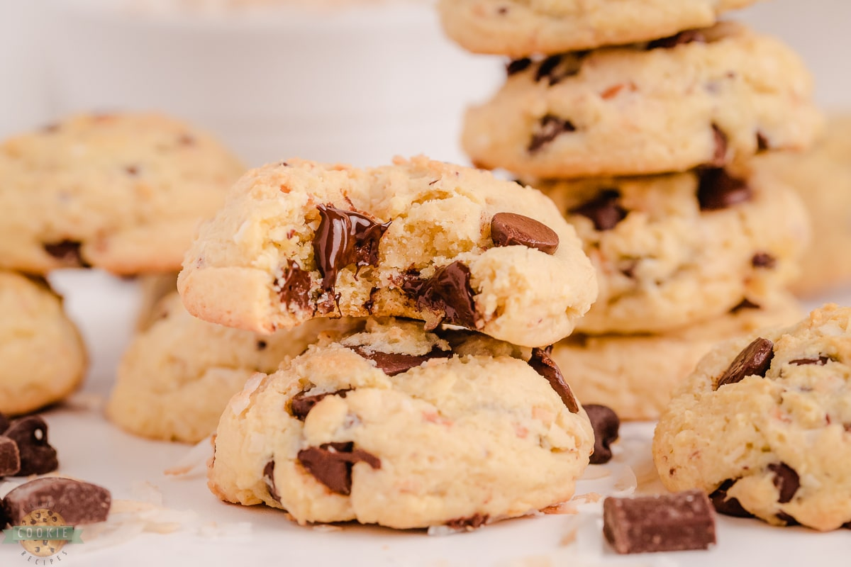 stacked coconut chocolate chip cookies with a bite taken out of one